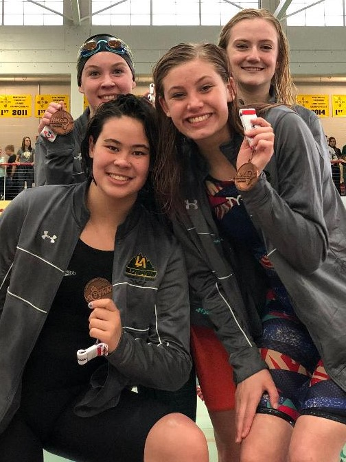 Cory Liechty, Katherine Elton,      co-captain Maddie Ovaska and Meredith McBranch finalled in the 200 free      relay at state..jpg