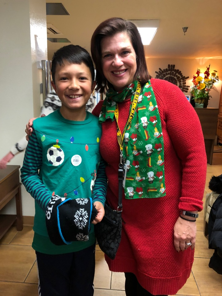 Megan Lee, third grade teacher at Chamisa & her son, James joined in the singing.jpg